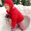 Grace Mosley, 6, crawls out of a snow tunnel in her front yard on Laurel St. during the February 3rd snowstorm on Friday.<br /> February 3, 2012<br /> staff photo/ David R. Jennings