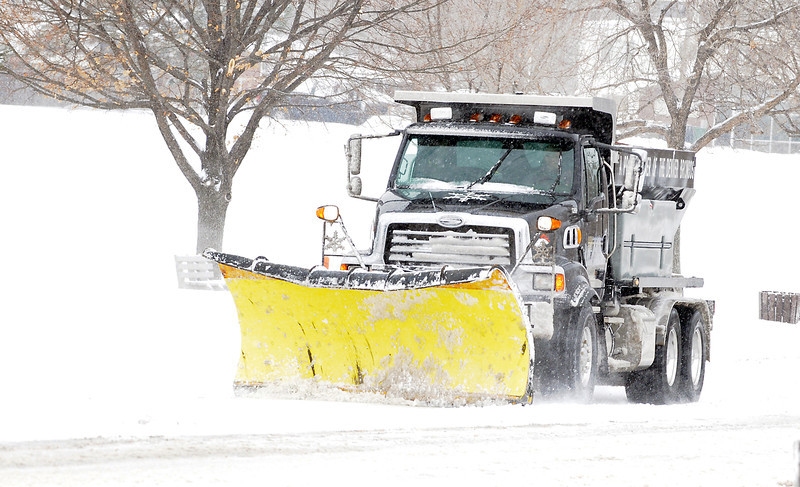 A snow plow clears Midway Blvd. during the February 3rd snowstorm.<br /> February 3, 2012<br /> staff photo/ David R. Jennings