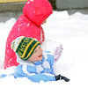 Holden Kohlmeyer, 5, front,  plays in the snow with Grace Mosley, 6, at Mosely's home on Laurel St. during the February 3rd snowstorm.<br /> February 3, 2012<br /> staff photo/ David R. Jennings