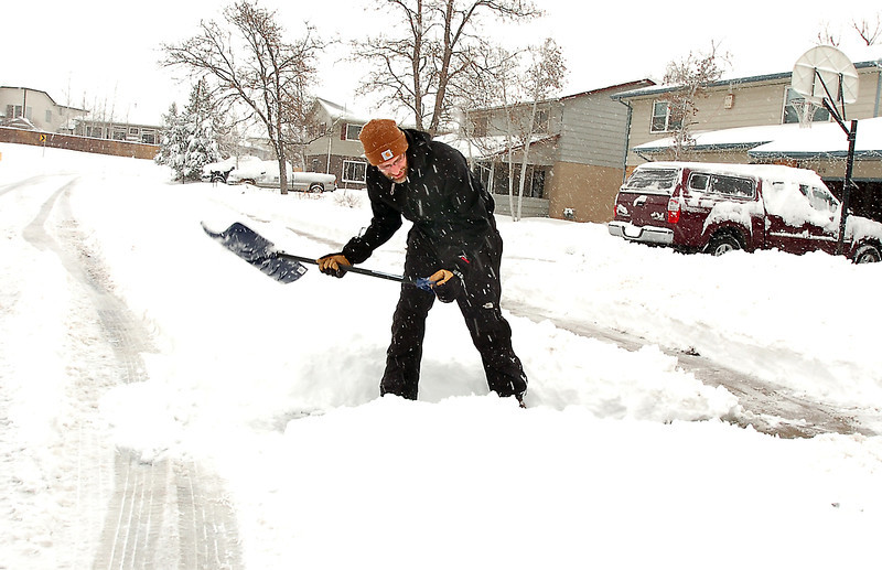 Chad Kohlmeyer clears a path to the street from his driveway on Laurel St. during the February 3rd snowstorm.<br /> February 3, 2012<br /> staff photo/ David R. Jennings