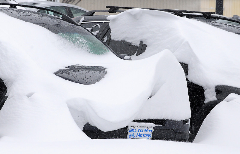 Wind blow snow patterns on cars at Sill Terhar Motors during the February 3rd snowstorm.<br /> February 3, 2012<br /> staff photo/ David R. Jennings