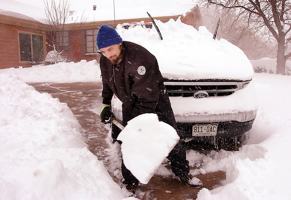 Jamey Archer digs out his truck at the corner of Midway Blvd. and Kohl St. during the February 3rd snowstorm.<br /> February 3, 2012<br /> staff photo/ David R. Jennings