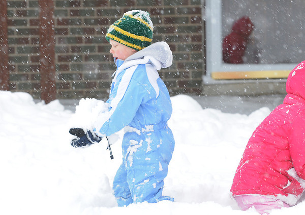 Holden Kohlmeyer, 5, left,  plays in the snow with Grace Mosley, 6, at Mosely's home on Laurel St. during the February 3rd snowstorm.<br /> February 3, 2012<br /> staff photo/ David R. Jennings