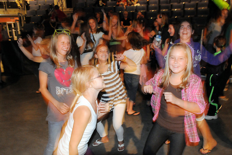 Students from Taps-n-Toes dance to the live music of Face during Dancing with the Broomfield Stars on Thursday at 1stBank Center.<br /> <br /> September 23, 2010<br /> staff photo/David R. Jennings