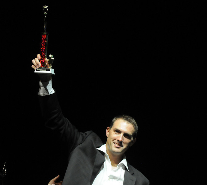 Beau Smith raises his trophy after he and Carlee Taga won the Dancing with the Broomfield Stars on Thursday at 1stBank Center.<br /> <br /> September 23, 2010<br /> staff photo/David R. Jennings