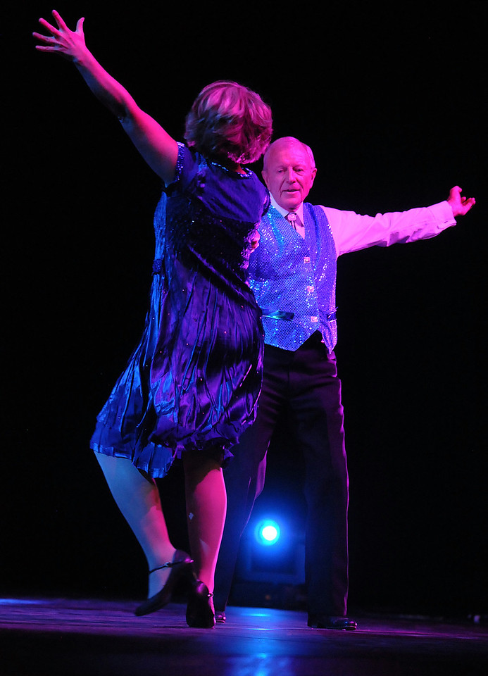 Dr. Bill Markel and Heidi Thomas perfom a swing dance during Dancing with the Broomfield Stars on Thursday at 1stBank Center.<br /> <br /> September 23, 2010<br /> staff photo/David R. Jennings
