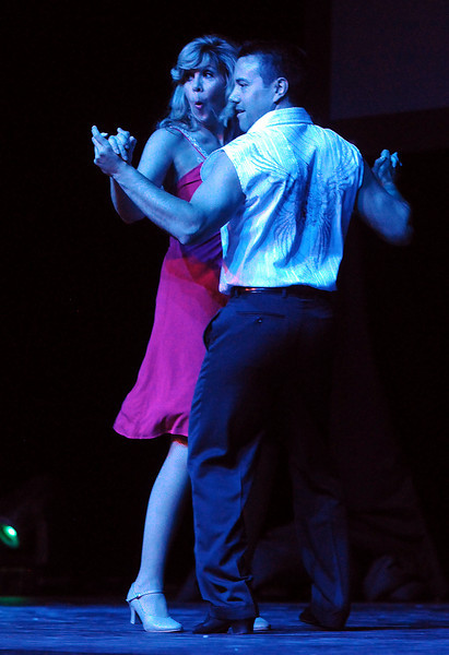 Jennifer Kerr and Tony Trujillo dance the Cha Cha during Dancing with the Broomfield Stars on Thursday at 1stBank Center.<br /> <br /> September 23, 2010<br /> staff photo/David R. Jennings