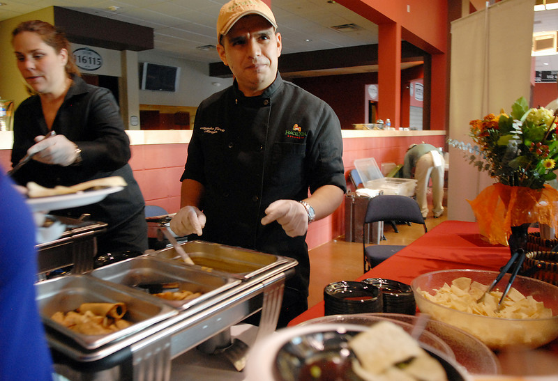 Alejondro Garcia serves food for the Hacienda restaurant during Dancing with the Broomfield Stars on Thursday at 1stBank Center.<br /> <br /> September 23, 2010<br /> staff photo/David R. Jennings