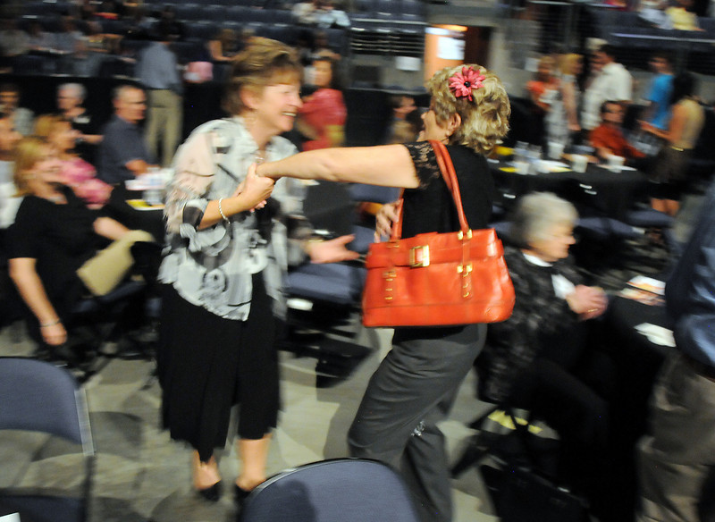 Bev Ferguson and Patti Willardson, with Bal Swan, dance in the audience during Dancing with the Broomfield Stars on Thursday at 1stBank Center.<br /> <br /> September 23, 2010<br /> staff photo/David R. Jennings