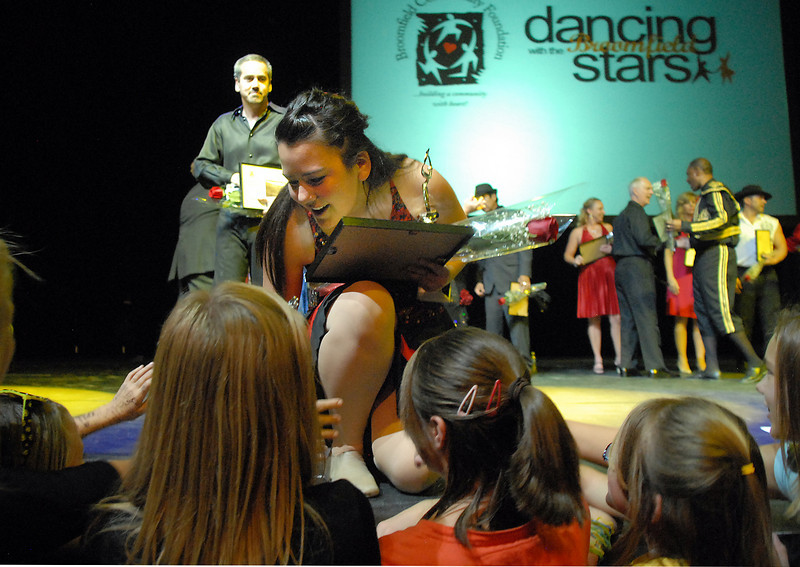 Carlee Taga talks with Taps-n-Toes students after winning the Dancing with the Broomfield Starswith Beau Smith on Thursday at 1stBank Center.<br /> <br /> September 23, 2010<br /> staff photo/David R. Jennings