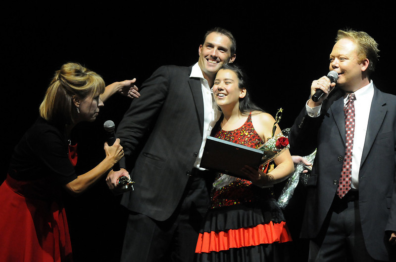Emcees Kim Christiansen, left, and Kirk Montgomery, right, announce Beau Smith and Carlee Taga as the winners of Dancing with the Broomfield Stars on Thursday at 1stBank Center.<br /> <br /> September 23, 2010<br /> staff photo/David R. Jennings