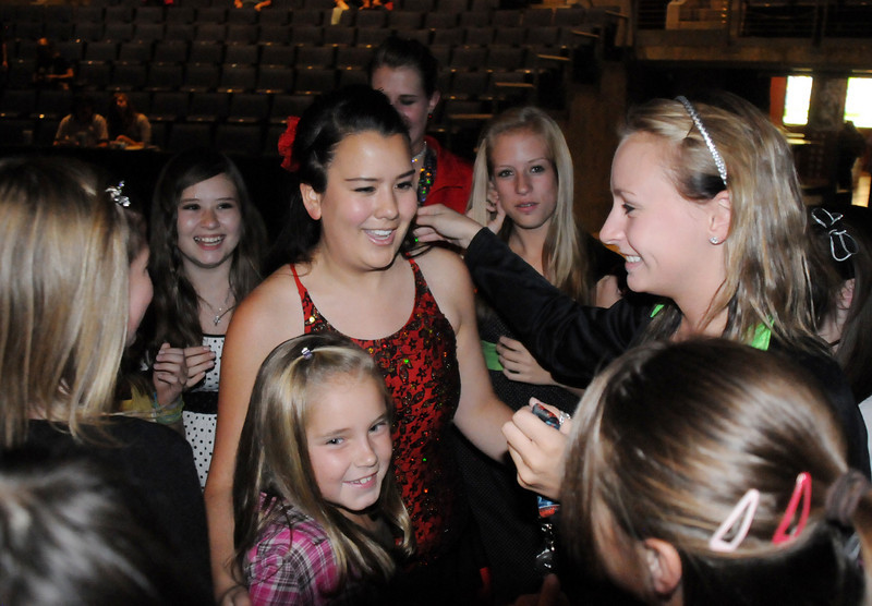 Carlee Taga, center, greets Taps-n-Toes students after the dance performances at Dancing with the Broomfield Stars on Thursday at 1stBank Center.<br /> <br /> September 23, 2010<br /> staff photo/David R. Jennings