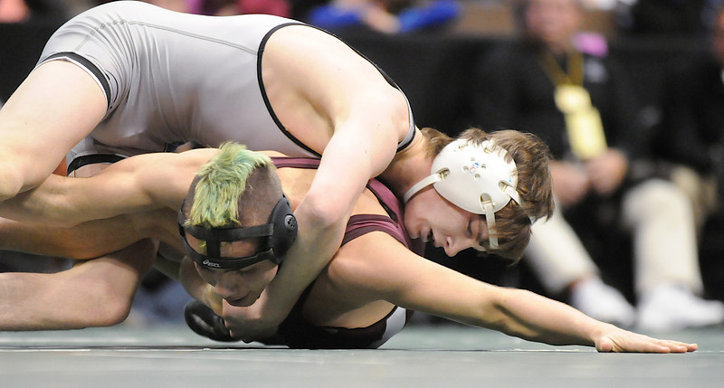 Courtland Hacker, Broomfield, wrestling to defeat Dan Salazar, Palisade, in the 119 lb. bout at the state 4A wrestling championships at the Pepsi Center on Saturday. <br /> February 20, 2010<br /> Staff photo/David R. Jennings