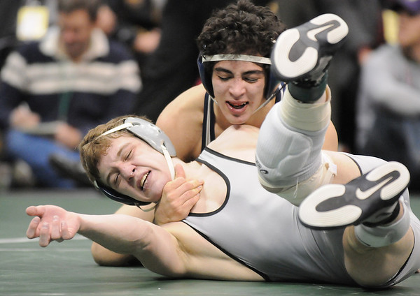 Jerry Huff, left, Broomfield, wrestles Joseph Martinez,Greeley West, in the 125 lb. bout at the state 4A wrestling championships at the Pepsi Center on Saturday.  Martinez won the bout.<br /> February 20, 2010<br /> Staff photo/David R. Jennings