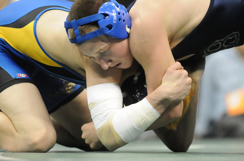 Nick Babcock, Broomfield, wrestles Nick Swanson, Wheatridge, in the 130 lb. bout at the state 4A wrestling championships at the Pepsi Center on Saturday.  Swanson won the bout.<br /> February 20, 2010<br /> Staff photo/David R. Jennings