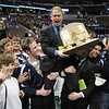 Broomfield's head coach Mark Schmidt holds the state 4A team championship trophy  while the team carries him on the mat during the  state 4A wrestling championships at the Pepsi Center on Saturday.  <br /> February 20, 2010<br /> Staff photo/David R. Jennings