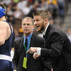 Assistant coach Matt Schmidt, right, gives pointers to Nick Babcock, Broomfield, while wrestling Nick Swanson, Wheatridge, in the 130 lb. bout at the state 4A wrestling championships at the Pepsi Center on Saturday.  Swanson won the bout.<br /> February 20, 2010<br /> Staff photo/David R. Jennings