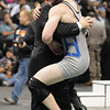 Josh VanTine, Broomfield, jumps into the arms of his father Mark after defeating Bryce Gaber, Montrose, in the 171 lb. bout at the state 4A wrestling championships at the Pepsi Center on Saturday.  February 20, 2010<br /> Staff photo/David R. Jennings