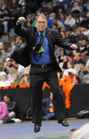 Broomfield's head coach Mark Schmidt reacts as Josh VanTine,  defeats Bryce Gaber, Montrose, in the 171 lb. bout to ensure a repeat team championship at the state 4A wrestling championships at the Pepsi Center on Saturday.  <br /> February 20, 2010<br /> Staff photo/David R. Jennings