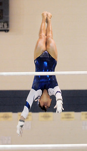 Gabby Maiden, Broomfield, does the dismount for her routine on the bars during the state 5A gymnastics meet at Thornton High School on Friday.  November 4, 2011 staff photo/ David R. Jennings