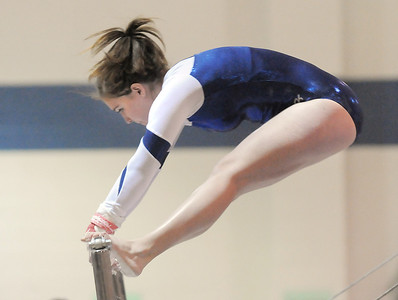 Kelsey Dilz, Broomfield, performs her routine on the bars during the state 5A gymnastics meet at Thornton High School on Friday.  November 4, 2011 staff photo/ David R. Jennings