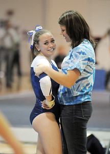 Allie Burgess, Broomfield, is comforted by coach Erika Taga after her routine on the beam during the state 5A gymnastics meet at Thornton High School on Friday.  November 4, 2011 staff photo/ David R. Jennings