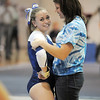Allie Burgess, Broomfield, is comforted by coach Erika Taga after her routine on the beam during the state 5A gymnastics meet at Thornton High School on Friday.<br /> <br /> November 4, 2011<br /> staff photo/ David R. Jennings