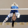 Gabby Maiden, Broomfield, does the dismount for her routine on the bars during the state 5A gymnastics meet at Thornton High School on Friday.<br /> <br /> November 4, 2011<br /> staff photo/ David R. Jennings