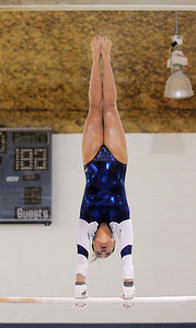 Gabby Maiden, Broomfield, performs her routine on the bars during the state 5A gymnastics meet at Thornton High School on Friday.  November 4, 2011 staff photo/ David R. Jennings