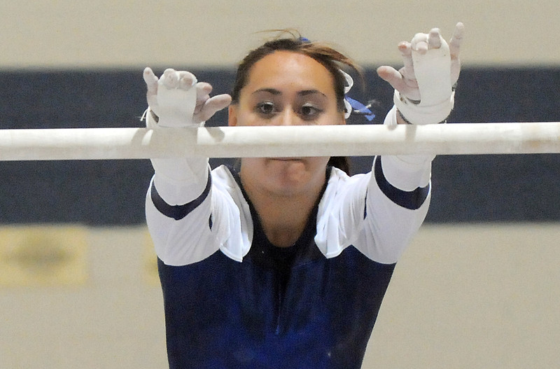 Gabby Maiden, Broomfield, reaches for the bar during her routine at the state 5A gymnastics meet at Thornton High School on Friday.<br /> <br /> <br /> November 4, 2011<br /> staff photo/ David R. Jennings