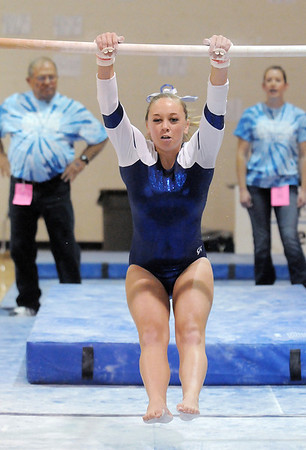 Allie Burgess, Broomfield, performs her routine on the bars  during the state 5A gymnastics meet at Thornton High School on Friday.<br /> <br /> November 4, 2011<br /> staff photo/ David R. Jennings