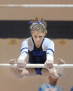 Melanie Stelling, Broomfield, performs her routine on the bars during the state 5A gymnastics meet at Thornton High School on Friday.  November 4, 2011 staff photo/ David R. Jennings