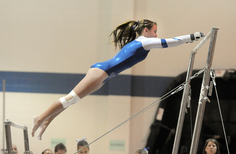 Jessica Riley, Broomfield, performs her routine on the bars during the state 5A gymnastics meet at Thornton High School on Friday.<br /> <br /> November 4, 2011<br /> staff photo/ David R. Jennings