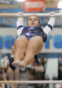Breanne Claussen, Broomfield, performs her routine on the bars during the state 5A gymnastics meet at Thornton High School on Friday.   November 4, 2011 staff photo/ David R. Jennings