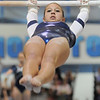 Breanne Claussen, Broomfield, performs her routine on the bars during the state 5A gymnastics meet at Thornton High School on Friday.<br /> <br /> <br /> November 4, 2011<br /> staff photo/ David R. Jennings