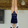 Melanie Stelling, Broomfield, performs her routine on the bars during the state 5A gymnastics meet at Thornton High School on Friday.<br /> <br /> November 4, 2011<br /> staff photo/ David R. Jennings