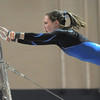 Broomfield's Kate Knights, after recovering from a nose bleed, performs her routine on the bars during the state 5A gymnastics meet at Thornton High on Friday. <br /> November 5, 2010<br /> staff photo/David R. Jennings