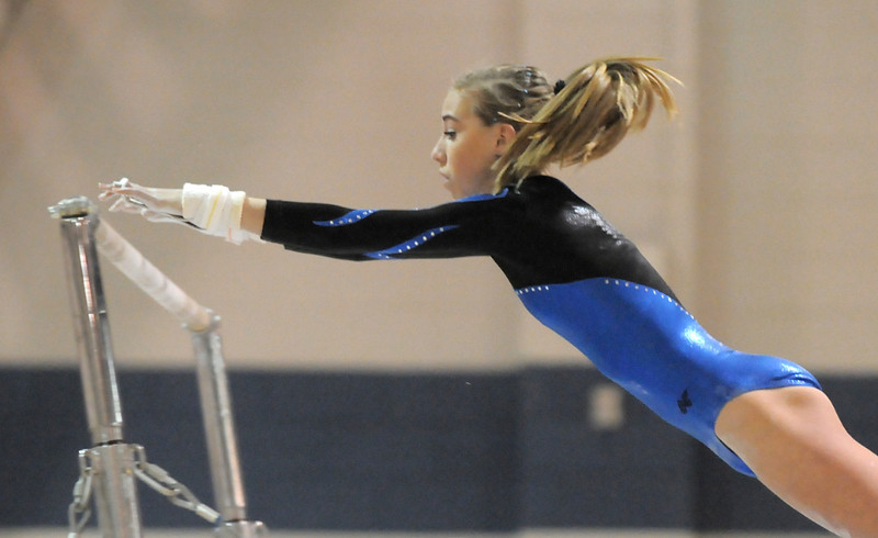 Broomfield's Mariah Hayden reaches to a bar while performing her state routine during competition in the state 5A gymnastics meet at Thornton High on Friday. <br /> November 5, 2010<br /> staff photo/David R. Jennings
