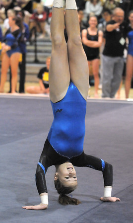 BE1111GYM42<br /> Broomfield's Melanie Stelling performs her floor routine during the state 5A gymnastics meet at Thornton High on Friday. <br /> November 5, 2010<br /> staff photo/David R. Jennings