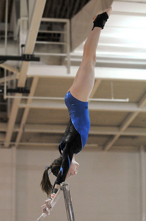 Broomfield's Kate Knights performs her routine on the bars during the state 5A gymnastics meet at Thornton High on Friday. <br /> November 5, 2010<br /> staff photo/David R. Jennings
