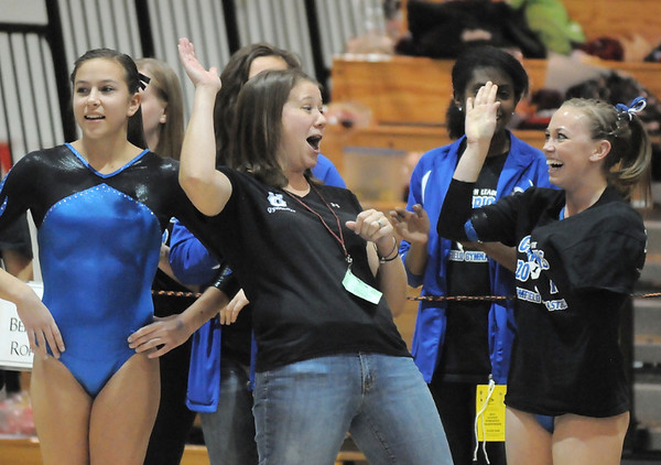 Broomfield's coach Erika Taga, left, and Allie Burgess cheer after seeing Burgess' floor routine score during the state 5A gymnastics meet at Thornton High on Friday. <br /> November 5, 2010<br /> staff photo/David R. Jennings