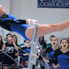Broomfield's Allie Burgess is cheered on by teammates while performing on the bars during the state 5A gymnastics meet at Thornton High on Friday. <br /> November 5, 2010<br /> staff photo/David R. Jennings