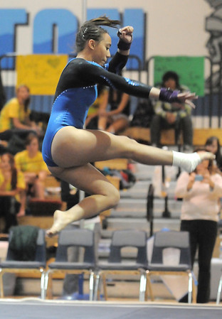 Broomfield's Gabby Maiden performs her floor routine during the state 5A gymnastics meet at Thornton High on Friday. <br /> November 5, 2010<br /> staff photo/David R. Jennings