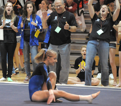 Broomfield's coach Erika Taga, right, and Bob Prince give a cheer after Melanie Stelling finishes her floor performance during the state 5A gymnastics meet at Thornton High on Friday. <br /> November 5, 2010<br /> staff photo/David R. Jennings