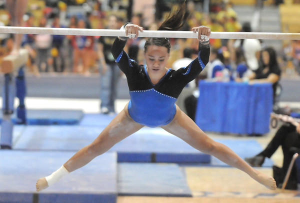 Broomfield's Gabby Maiden performs a routine on the bars while competing in the state 5A gymnastics meet at Thornton High on Friday. <br /> November 5, 2010<br /> staff photo/David R. Jennings