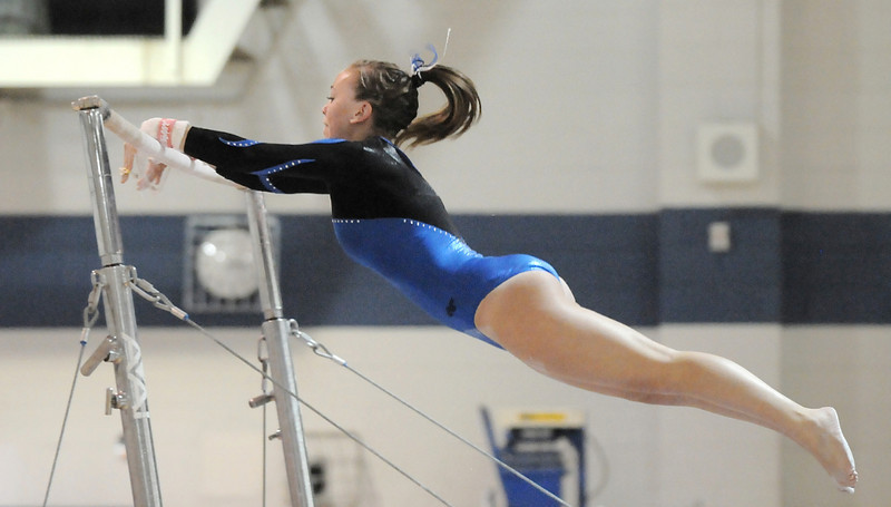 Broomfield's Allie Burgess jumps from bar to bar during her routine at the state 5A gymnastics meet at Thornton High on Friday. <br /> November 5, 2010<br /> staff photo/David R. Jennings