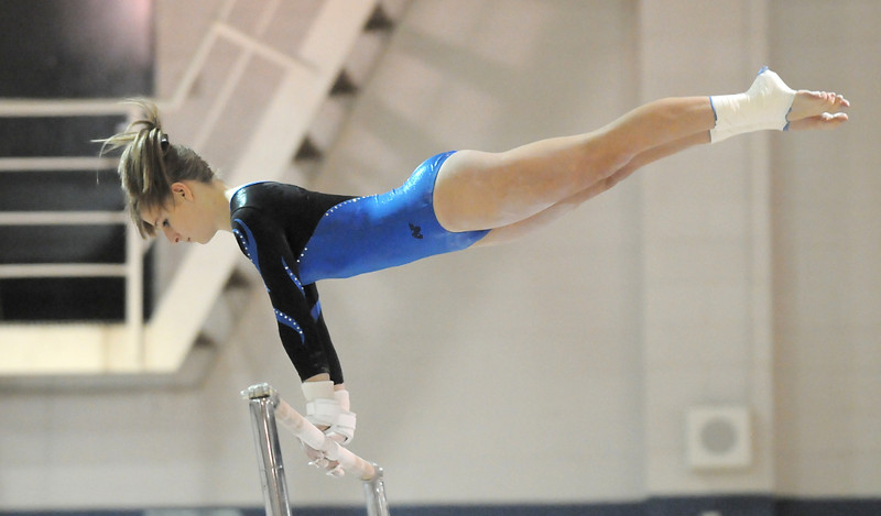 1111GYM05<br /> Broomfield's Melanie Stelling performs a routine on the bars while competing in the state 5A gymnastics meet at Thornton High on Friday. <br /> November 5, 2010<br /> staff photo/David R. Jennings