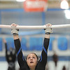 Broomfield's Amy Baum performs a routine on the bars while competing in the state 5A gymnastics meet at Thornton High on Friday.<br /> November 5, 2010<br /> staff photo/David R. Jennings