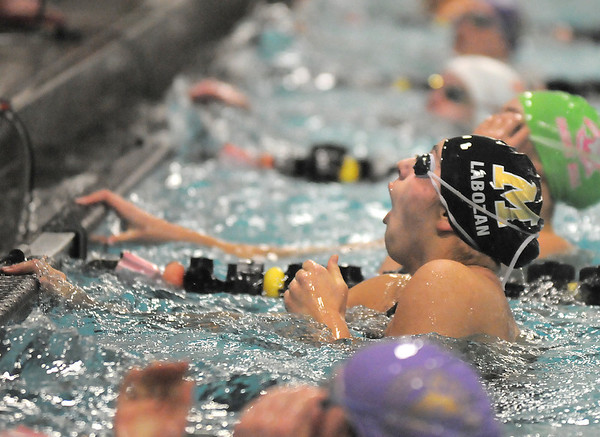 Monarch's Anna Labazon reacts after seeing her winning time in the 50 yard freestyle during the Coaches Invitational Swim Meet at Mountain View Aquatic Center in Loveland on Saturday.<br /> <br /> Gail Davies<br /> <br /> December 18, 2010<br /> staff photo/David R. Jennings