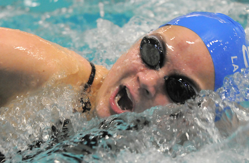 Broomfield's Broomfield's Katalena Laufasa-Duncan launches off of the starting blocks swimming the freestyle in the 200 yard IMduring the Coaches Invitational Swim Meet at Mountain View Aquatic Center in Loveland on Saturday. <br /> <br /> December 18, 2010<br /> staff photo/David R. Jennings